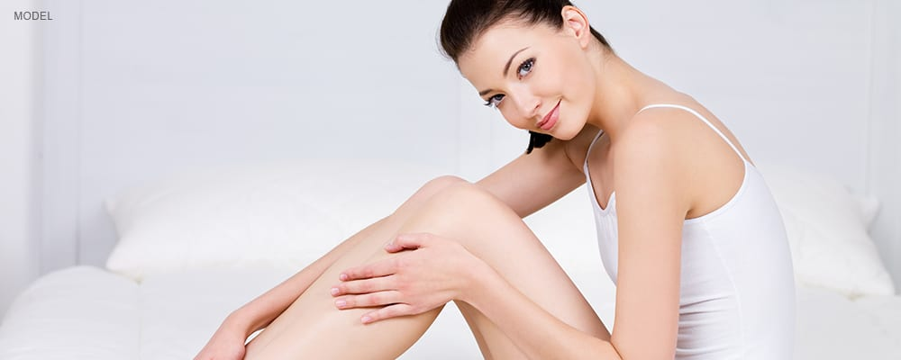 AAMedspa_LaserHair Removal_FemaleSitting on bed touching legs
