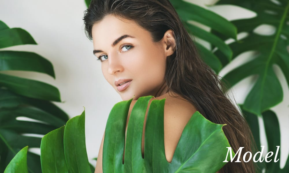 Model Behind Large Green Leaves
